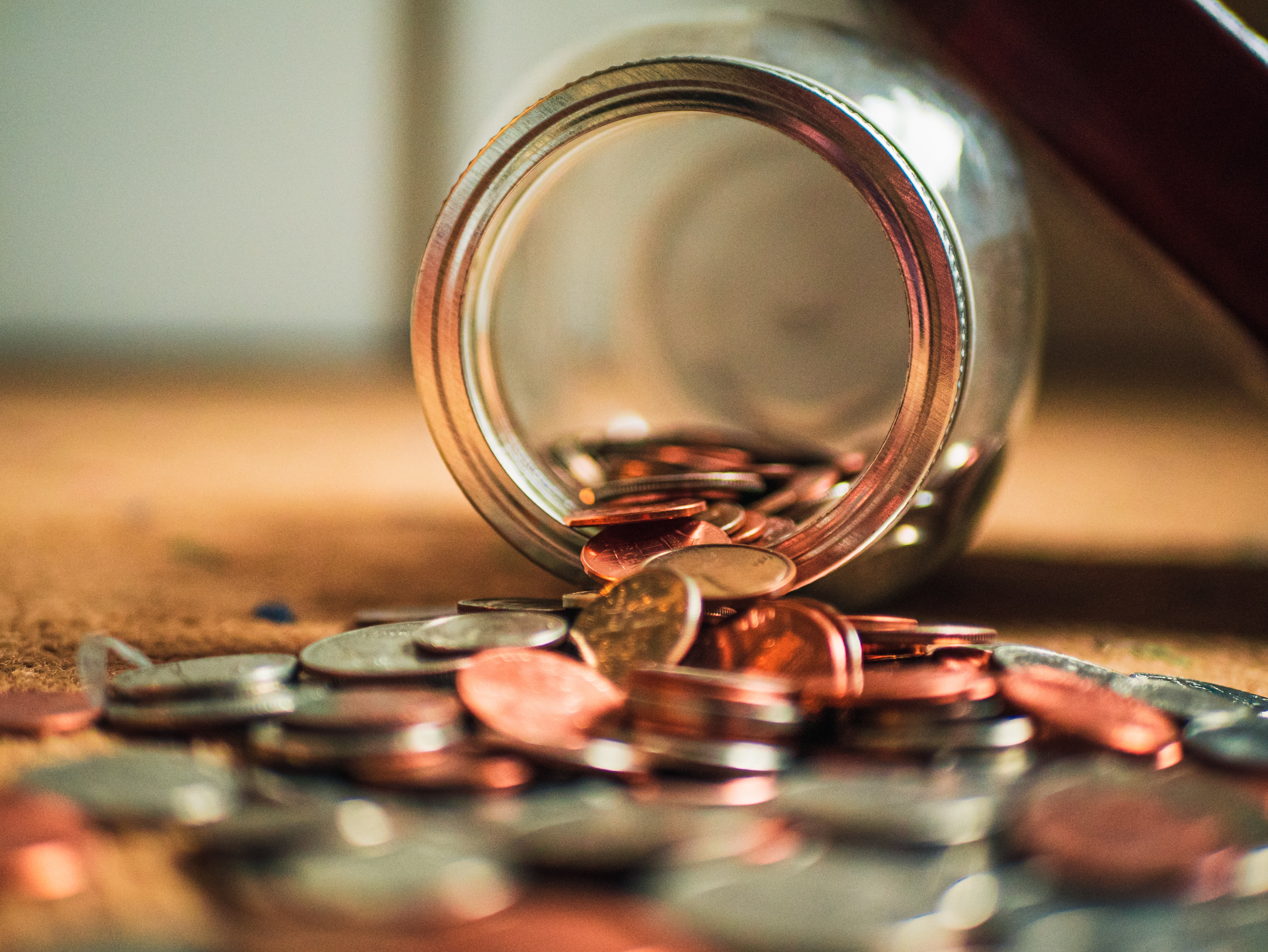 coins scattered from jar